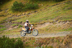 Motocross. Amateur motocross drivers have hobby ride on mountains road Stock Photography