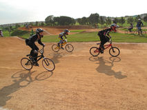 Motocross bicycle racers off the start during bmx finals Royalty Free Stock Images