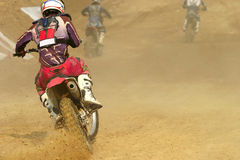 Motocross bike increase speed in track Royalty Free Stock Photography