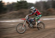 Motocross bike in a race. Close-up Royalty Free Stock Image
