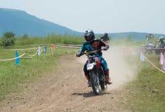 Motocross bike racer overtaking in high speed. Motocross bike racer overtaking in high speed leaving everyone behind. Winner royalty free stock photo