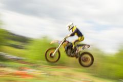 Motocross bike rider jumping in motion Royalty Free Stock Photos