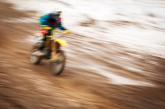Motocross bike rider in motion Stock Images
