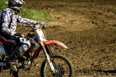 Motocross bike and rider royalty free stock photos