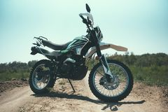 motocross bike stands on a sandy road royalty free stock photo