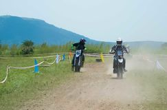 Motocross biker racer looking for his teammate. Who left behind. Motocross team event royalty free stock photography