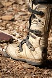 Motocross boot. Close view of a motocross boot on the dirt Royalty Free Stock Photo