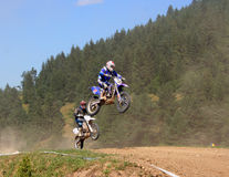 Motocross Championship. Motorbikes jumping high at the European motocross championship in Zarnesti, Romania Royalty Free Stock Photo