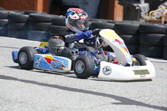 Kid driving competition kart on training Royalty Free Stock Photos
