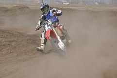 Motocross, curseurs de moto, virage Photos stock