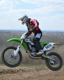 Motocross: the desire to win. In the quest to defeat the riders literally fly to the finish line Royalty Free Stock Images