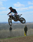 Motocross: the desire to win. In the quest to defeat the riders literally fly to the finish line Stock Photos