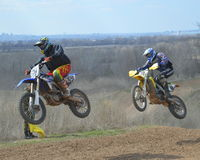 Motocross: the desire to win stock photography