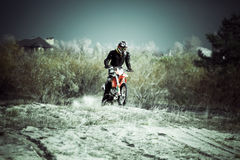Motocross dirt bike on sand. Motocross dirt bike riding on sand Royalty Free Stock Images