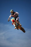 Motocross dirtbike in the air. View of a motorcross dirtbike on the dirt performing a jump Stock Image