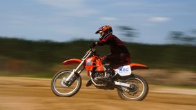 Motocross Dirtbike Racing Scene Motion Blur. Photo taken during a vintage motocross race. This was vintage bike weekend at the facility Stock Photo