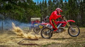Motocross Dirtbike Racing Scene at the Start. Photo taken at the start of a motocross race. This was vintage bike weekend at the facility Royalty Free Stock Photos