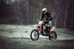 Motocross dirtbike rider on sand Stock Photos