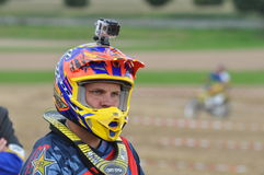 Motocross driver with mounted helmet camera Royalty Free Stock Image