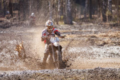 Motocross driver in mud Stock Images