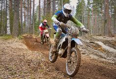 Motocross drivers in competition on the race track.  Royalty Free Stock Images