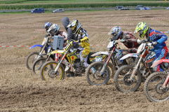 Motocross drivers starting the race Royalty Free Stock Photos