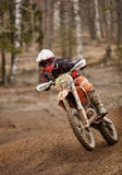 Motocross  enduro driver accelerating the motorbike on the race track Stock Photo