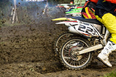 Motocross extreme sport. Dynamic action with pieces of ground in air - start of motorcross race Stock Images