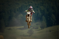 Motocross fly. Motocross rider in the air Royalty Free Stock Photo
