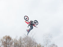 Motocross freestyle rider One Hand Back Flip jump Royalty Free Stock Photo