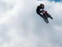 Motocross freestyle rider One Hand Hello Whip jump Royalty Free Stock Photography