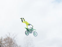 Motocross freestyle rider One Hand Tail Grab jump Stock Image