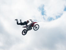 Motocross freestyle rider Tail Grab jump Royalty Free Stock Photos