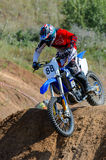 Motocross high jump. The young sportsman on a motorcycle jump Royalty Free Stock Photo