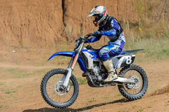 Motocross high jump. The young sportsman on a motorcycle jump Royalty Free Stock Photos