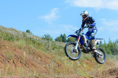 Motocross high jump. The young sportsman on a motorcycle jump Royalty Free Stock Photography