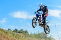 Motocross high jump. The young sportsman on a motorcycle jump Stock Photos