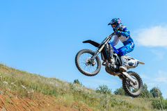 Motocross high jump. The young sportsman on a motorcycle jump Royalty Free Stock Image