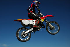 Motocross Jump. Motocross Race. Motorbike flying high royalty free stock photography