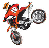 Motocross jump. A motocross rider jumping over the obstacles to win the race. He is so fast and agile nobody can keep up with him and the spectators love his Royalty Free Stock Image