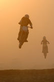 Motocross jump in dusty. Motocross jump in track and dusty evening Royalty Free Stock Image