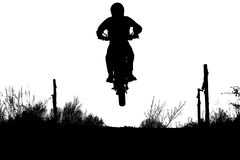 Motocross jump, extreme. A silhouette of jumping motocross racer Stock Photos