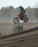 Motocross: jump on the trampoline. One of the features of the track - high jump. The athlete must jump and land successfully royalty free stock photos
