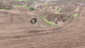 Motocross motorbike riders on a dirt track stock video footage