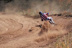 Motocross, motorcycle driver flies over hill out of snow Stock Image