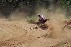 Motocross, motorcycle driver flies over hill out of snow Royalty Free Stock Image