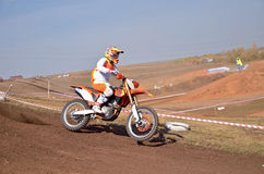 Motocross, motorcycle driver flies over hill out of snow Royalty Free Stock Photos