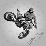 Motocross. Motorcycle jump on a gray background isolated Royalty Free Stock Image