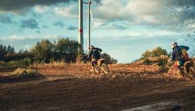 Motocross MX Rider riding on dirt track Royalty Free Stock Image