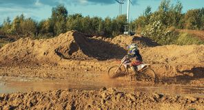 Motocross MX Rider riding on dirt track. Arnoldsweiler, Germany, October 05,2017:Extreme Motocross MX Rider riding on dirt track on a sunny late summer day on Stock Images